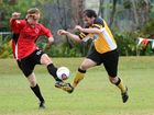 Alex Nolan battles with James Joyce at the soccer - Coffs United Vs Westlawn Tigers at McLean Street. Photo: Leigh Jensen / The Coffs Coast Advocate