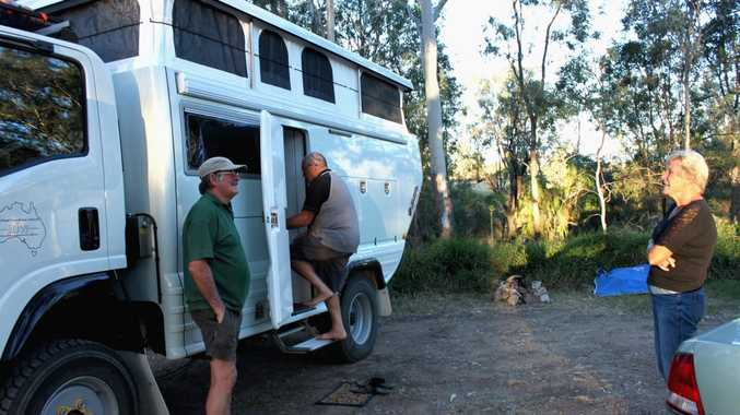 Tony Bates shows motohome 'Isabel' to interested fellow travellers.