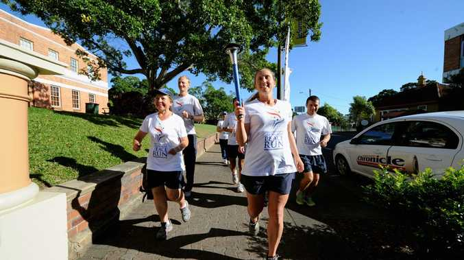Stacey Marsh leads the group on the Sri Chinmoy Oneness-Home Peace Run as they approach the steps of the Maryborough City Hall.