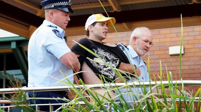 The 19-year-old brother of Kym David Baxter-Sayers is led back to the Hervey Bay police station after screaming abuse outside the courthouse.