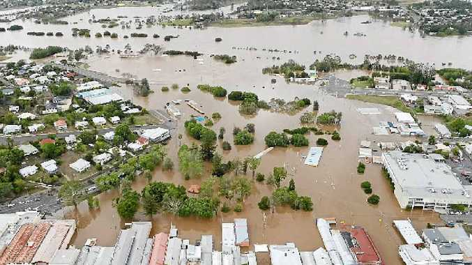 With the flood at its peak, Mary St is in the foreground looking west over Memorial and Albert Parks to the Mary River. 2013 aerial flood pictures of Gympie.