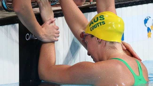 Alicia Coutts of Australia is consoled by teammates after the Swimming Women's 4x100m Freestyle on day nine of the 15th FINA World Championships