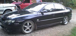 Police are asking the public to come forward with sightings of a black Commodore following a shooting at Lowmead.