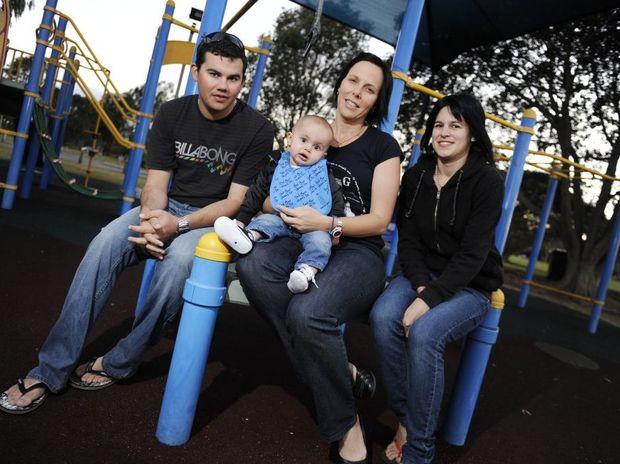 Twelve-month-old Tyler Batterham's dad Dean Batterham, aunt Michelle Kiss and mother Chantelle Davies support Jeans for Genes Day.
