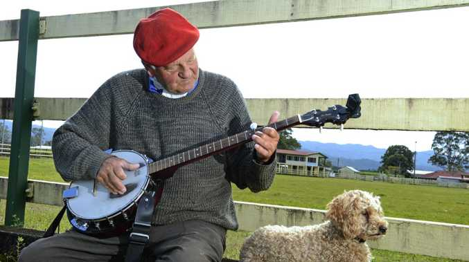 Geoff Westaway with his dog, Jarque, at Murwillumbah showgrounds with his Banjo.