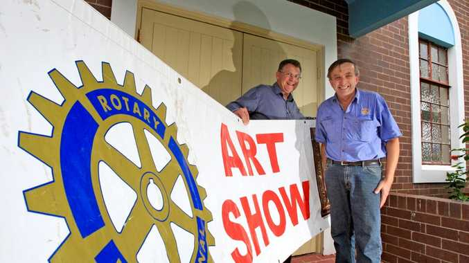 Lionel Cansdale and Ralph Dephoff prepare for the Murwillumbah Rotary Club's Art Show next month.
