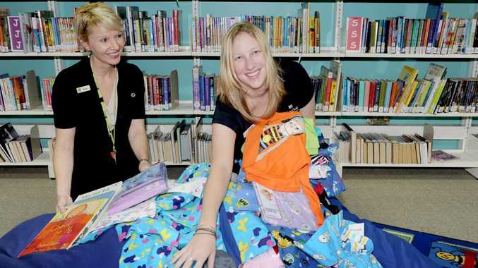 Customer service librarian Tara Webb and library assistant Bree Rochford at the Hervey Bay Library which is a drop-off point for the Pyjama Foundation pyjama drive.