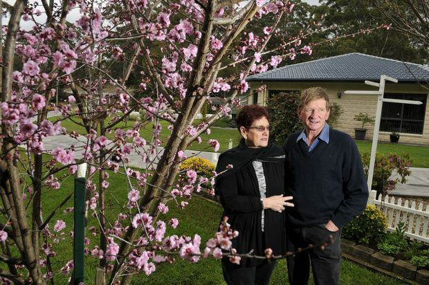 Dianna and Kevin Drew with a flowering plum tree.