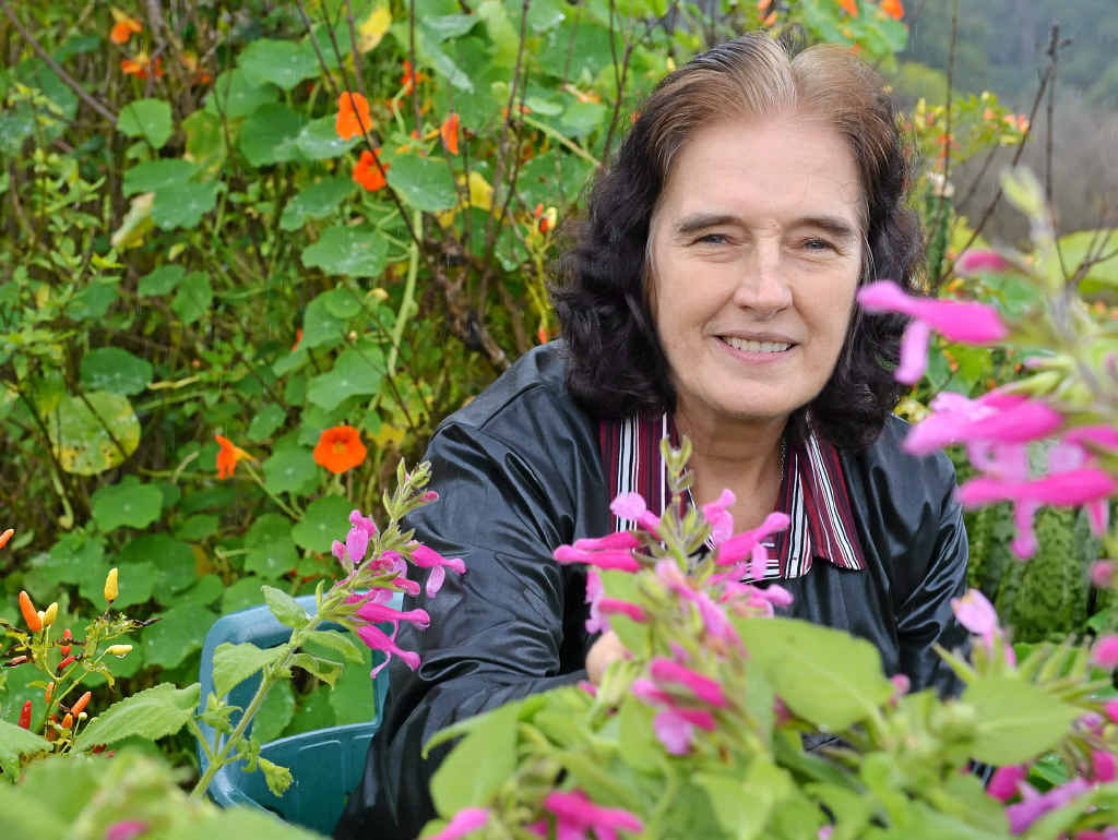Author Isabell Shipard among her herbs.