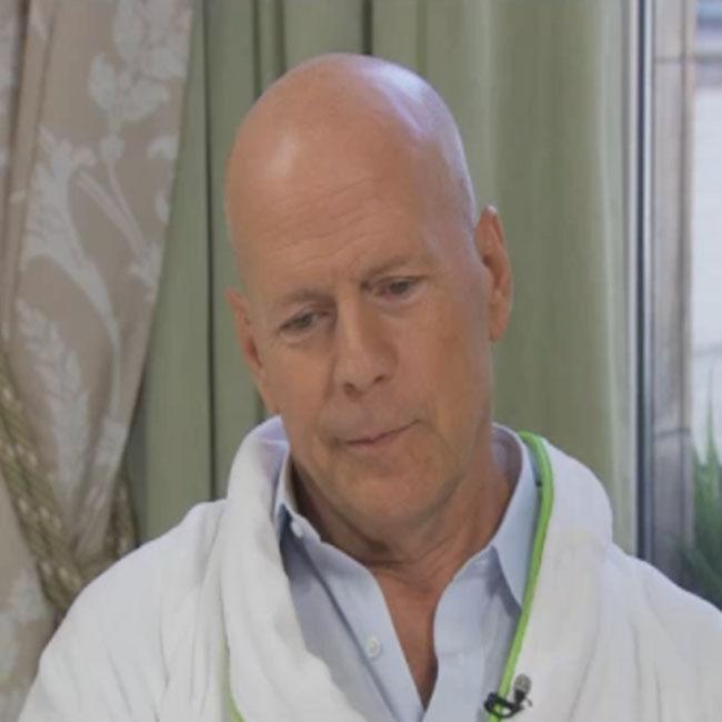 Bruce Willis in bathrobe on Daybreak.