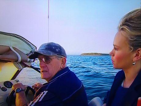 Sunrise's Edwina Bartholomew talks to boat driver 'Jacko' on the way to Pelican Bank.