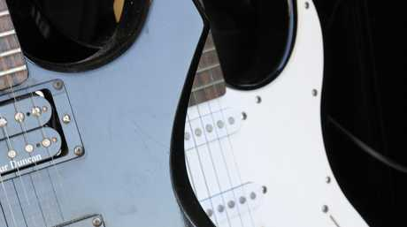 Two electric guitars are among the property recovered.