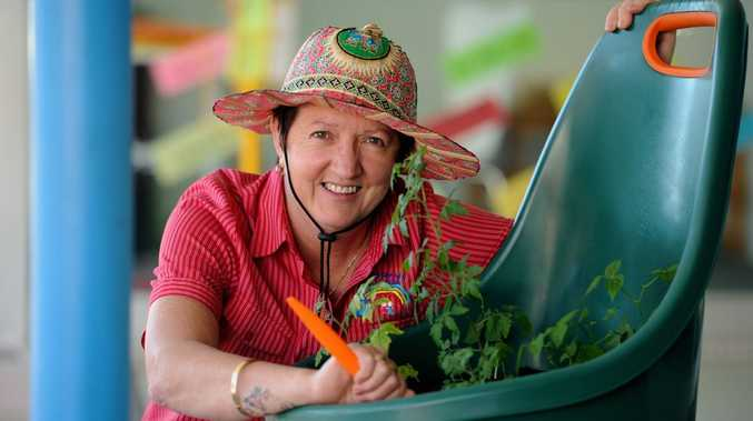 Child care co-ordinator Narelle Lightbody with the mobile garden in Bazaar St that is attracting a lot of attention. Narelle said the idea is to encourage sustainability and to prove that you don't need a large patch to grow vegetables.