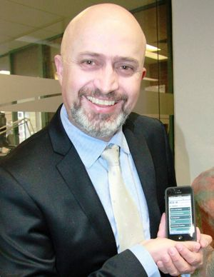 Council's acting general manager Troy Green shows off Council's handy app for smartphones, tablets and mobile devices.
