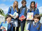 TOMORROW'S WRITERS: From left, Sam Nash, Lily Evans, Kallum Robinson, Jessica Buddem and Billy Bird from Trinity Catholic College Lismore with their favourite books from the Byron Writers Festival.