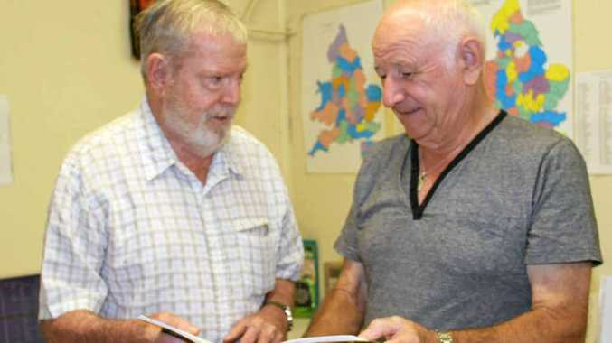 Jim Paton and Lan Gibson take a look through family history books at Mackay Family History Society.