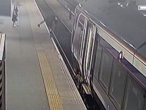 Rail co releases video of drunk passengers falling on tracks