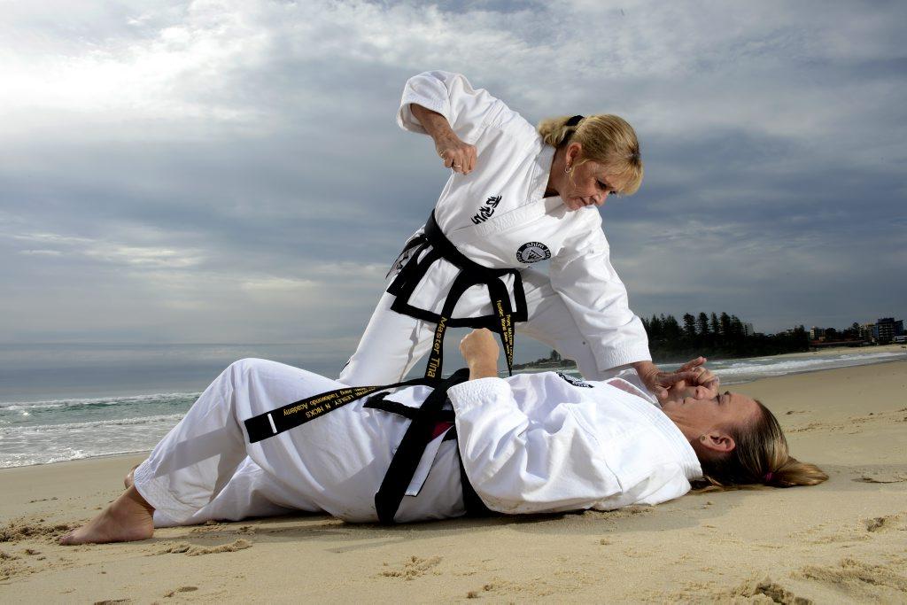Tina Johnson with Jacqui Ryan of Shim Jang Tae kwon do on Coolangatta Beach.