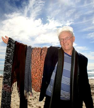 Tweed Shire Mayor Barry Longland with his selection of scarves.