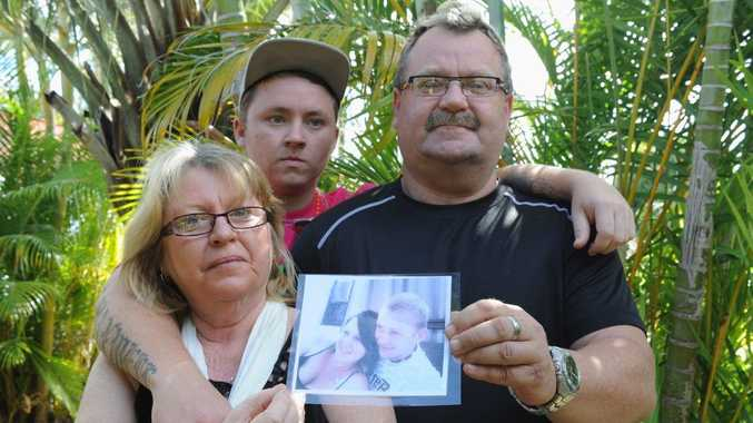 Brad Arndt with his partner Maxine Smith and her son Dakota Smith. Brad is holding a picture of his son Liam Arndt and his girlfriend Kailah O'Keeffe. Liam was killed in a car crash in NSW.