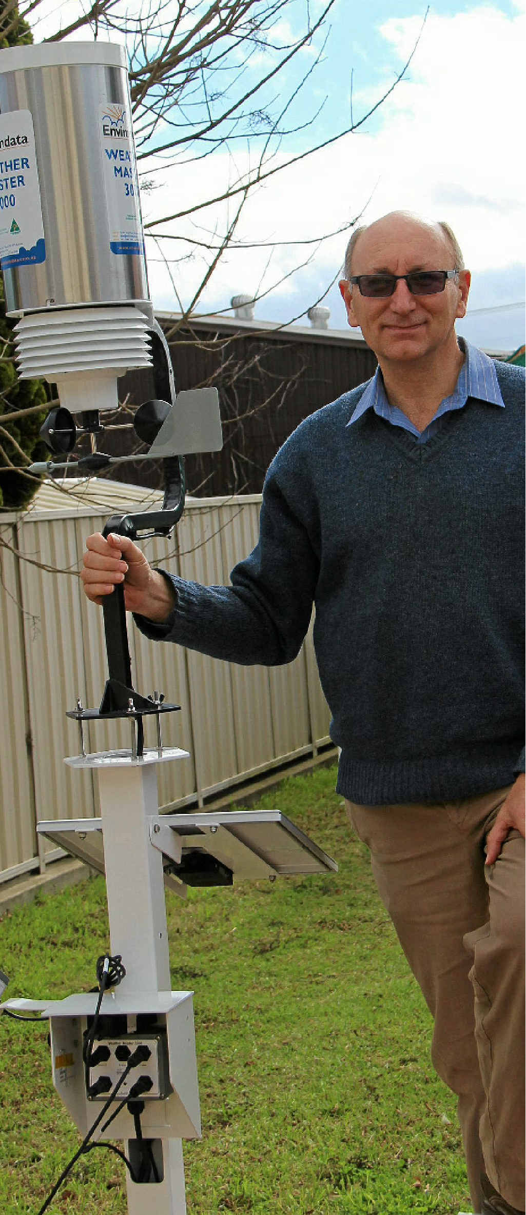 PROUD INVENTOR: Environdata founder Peter Rodeck shows off the Weathermaster, which is now 18 years old.