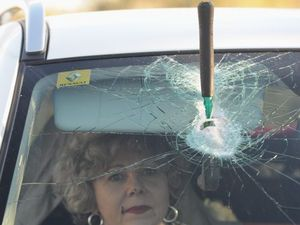 Driver's lucky escape as hammer smashes windscreen