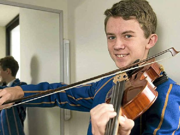 TUNING UP: Andrew Lumsden shows his technique at the eisteddfod.