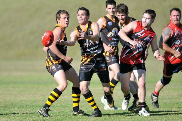 AFL -Sean Duroux and Les Cohen battle for the ball at the Sawtell/Toormina vs Grafton Tigers at Richardsons Oval. Photo: Leigh Jensen / The Coffs Coast Advocate