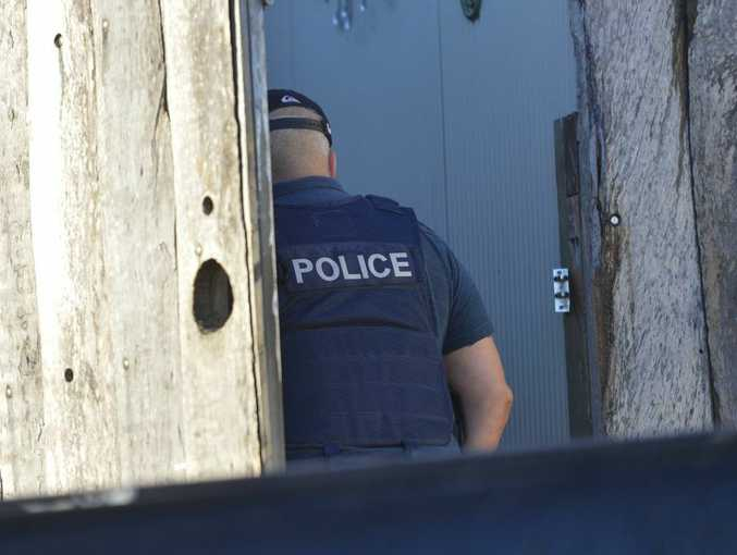 A house in Whiting Street Gladstone was raided by detectives on Monday morning.