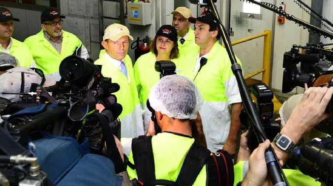 MEATWORKS MEETING: Opposition Leader Tony Abbott faces the press pack at JBS Australia's processing plant at Dinmore yesterday alongside LNP candidate for Blair Teresa Harding and shadow treasurer Joe Hockey (rear).
