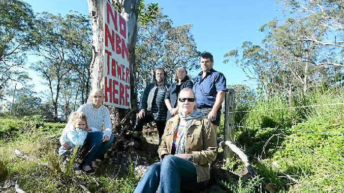 END OF THE LINE: Modanville locals Lacey McDougall, 5, Sheree McDougall, Greg Durrington, Joanna Whitney, Anton Ivan and Kylie Carey (front), are opposed to NBN towers being built close to schools and homes.