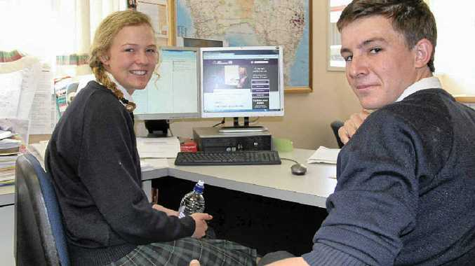 STUDYING UP: Scots PGC College students Alicia Seery and Matthew Locke study the Australian Electoral Commission website ahead of their first-ever voting experience in five weeks time.
