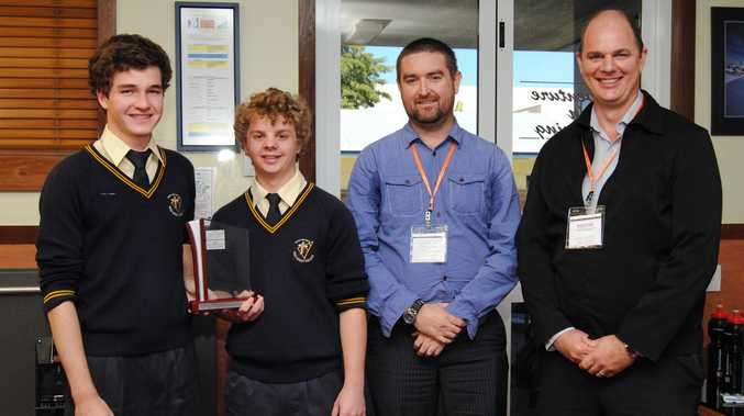 HSC Year 12 Students, Lachlan Brown and Benjamin Gampe, accepting their award from WorleyParsons Engineers, Desmond Searle and Michael Ridley.