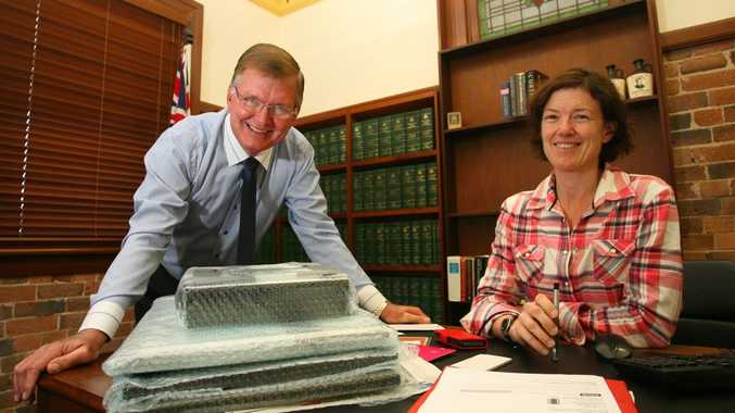 Barry Large and Kirsten Livermore in Kirsten's office as she packs up after Parliament was disolved. Photo: Chris Ison / The Morning Bulletin