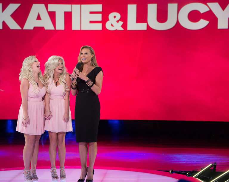 Katie and Lucy with host Sonia Kruger before they entered the house.