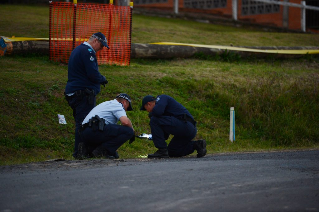 Police search a vacant block of land where explosive material was found about 50m from the Clay Street, West Ipswich, residence where explosive material was found last month.