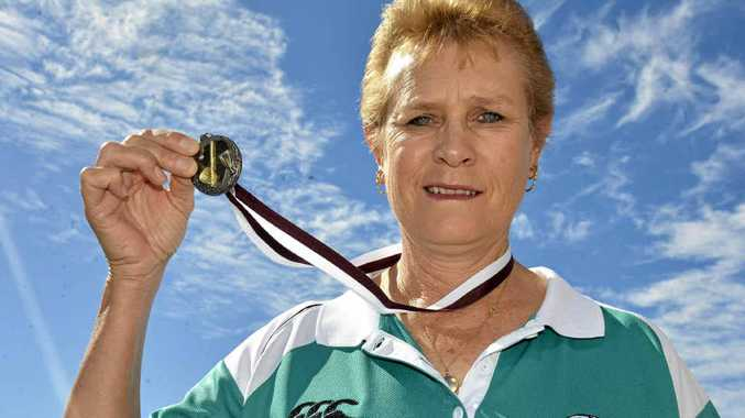 Sue Murray with her silver medal from the Queensland Masters Softball Carnival.