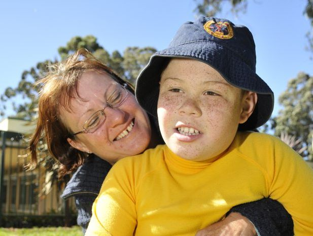 Jenny Jerome hugs her son Sam at Toowoomba West Special School.