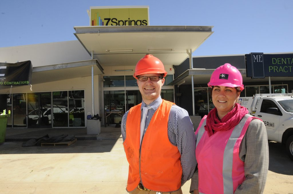 University of Queensland medical student Andrew Frazer and 7 Springs Medical Centre general manager Dene Creegan keep an eye on construction.
