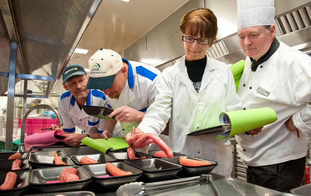 BBQ EXPERTS: Judges Steve Fleming, Steve Baranowski, Helen Olive and Barrie Jones look for a good snag.