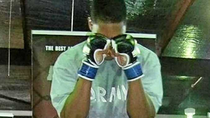 PREPARING: Michael McDaniel before one of his fights in mixed martial arts.