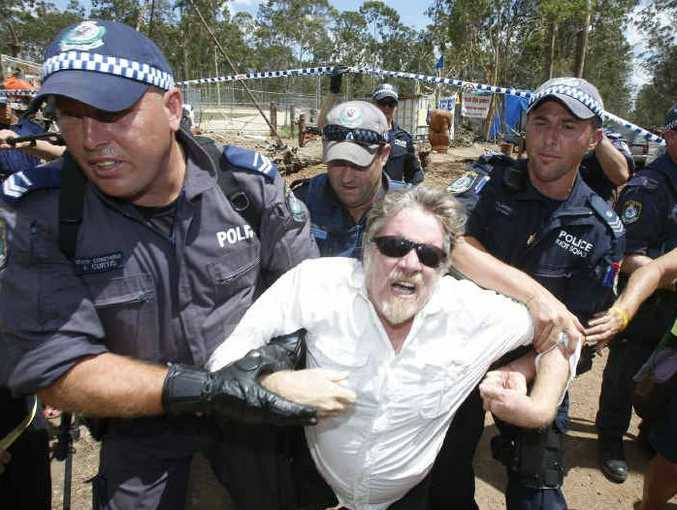 EYE CATCHING: Adam Hourigan's graphic image of a man being dragged from the picket line by police at the Glenugie anti-CSG protest earlier this year. It is one of two of Adam's photos nominated for the PANPA awards. Photos: Adam Hourigan