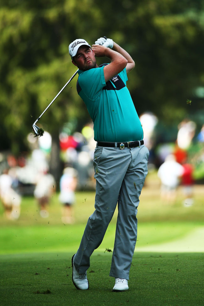 Marc Leishman hits a shot on the first hole during the third round of the 95th PGA Championship
