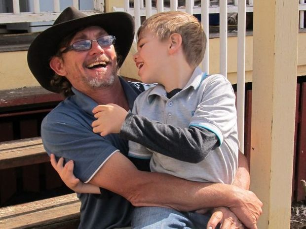 Angus Bowles (with his father, Phil) has had his surgery in the US delayed by a blood clot.