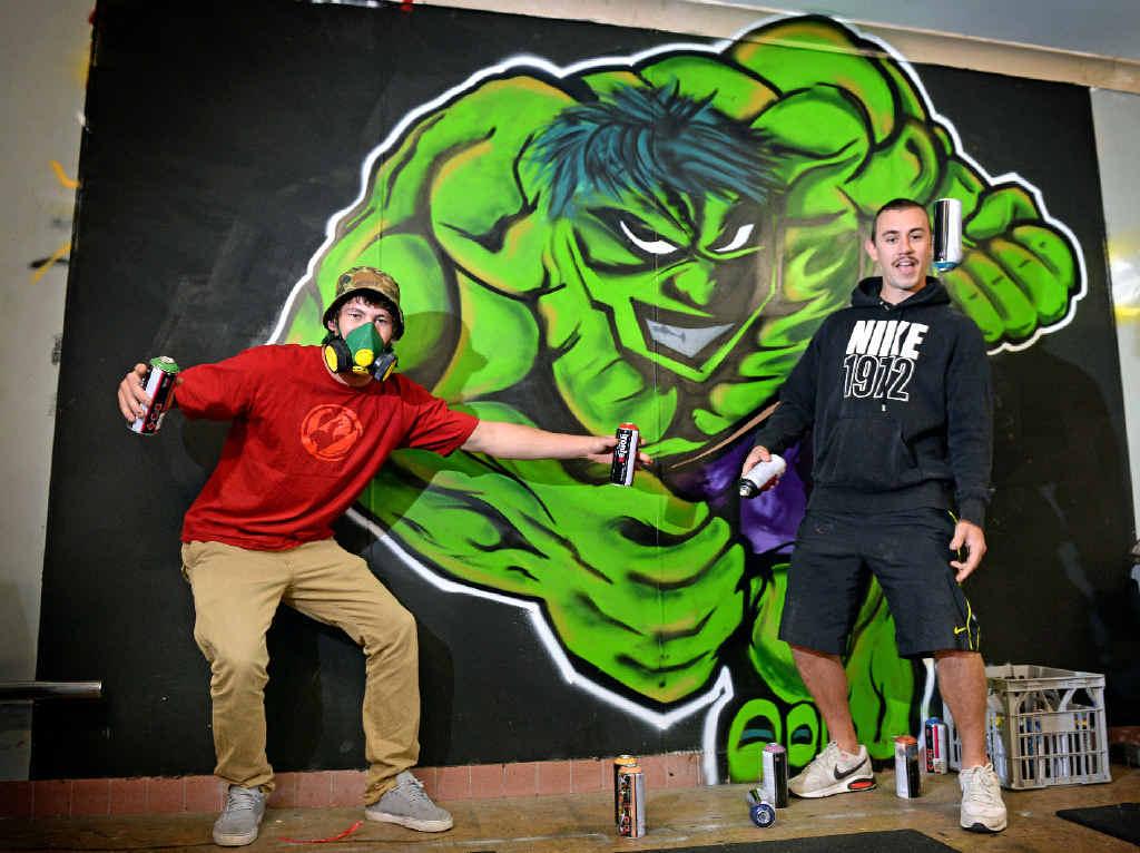 EMBLAZONED: Graffiti writers Joey Joyce and Lindon Vickers with their Incredible Hulk graffiti at Tweed Heads Seagulls club rooms.
