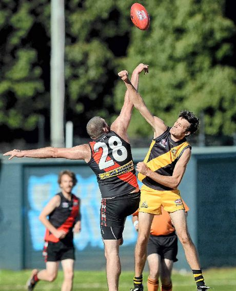 TALL ORDER: Ballina ruckman Joel McMullen (left) gets the jump on Tweed Coast rival Carson Bolt during the preliminary final.