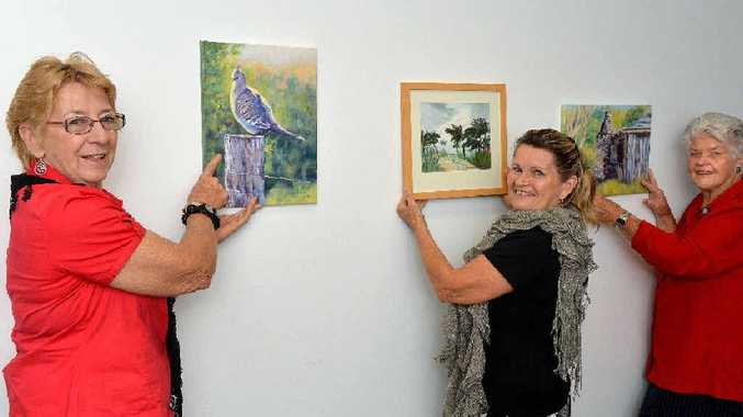 Di Richter, Rhonda O'Connor and Marie Hayes with some of their artwork that will be on show at Calen.