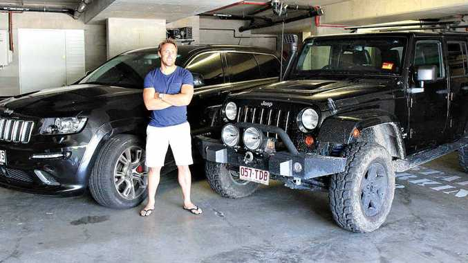 Big wave surfer Mark Visser with his Jeep duo.