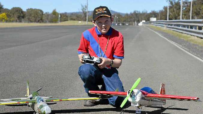 READY FOR TAKE-OFF: Reilly Thomson prepares to fly his model plane at the Warwick Aero Modellers meeting at the Warwick Dragway.