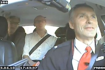 Mr Stoltenberg at work in the taxi.